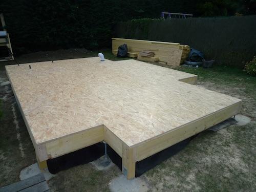Agrandissement de maison en ossature bois dalle en bois for Extension maison osb